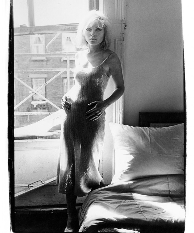 Debbie wearing a Stephen Sprouse dress in her apartment on Bowery