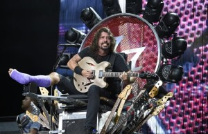 FILE - In this July 4, 2015 file photo, The Foo Fighters' Dave Grohl performs with a cast at RFK Stadium in Washington. Grohl fell onstage in Sweden last month and fractured his foot. (Photo by Nick Wass/Invision/AP, File)